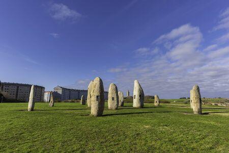 Menhirs and Hercules Tower (La Coruna, Spain). 版權商用圖片 - 146304345