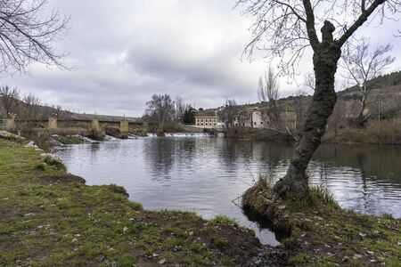 Medieval bridge in river walk of Duero river (Soria, Spain).