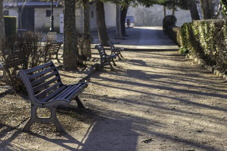Wooden benches in river walk of Duero river (Soria, Spain).