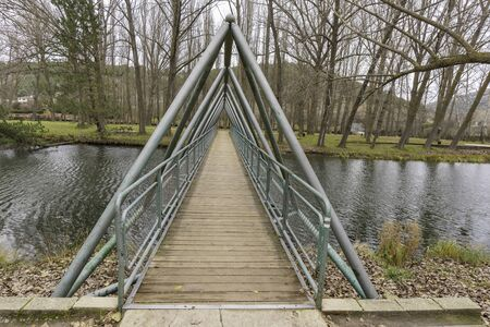 Wooden bridge in River walk in Duero river (Soria, Spain).