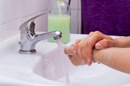 Someone washing their hands.