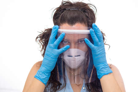 Girl using mask shield as virus protection.