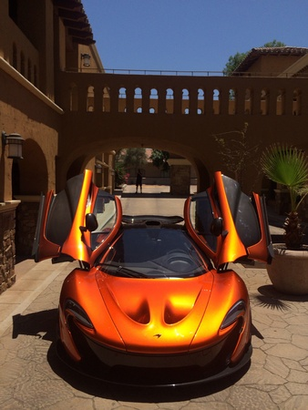 ferrari: McLaren P1 spreading its wings as the sun reflects off the sparkling Volcano Orange paint.
