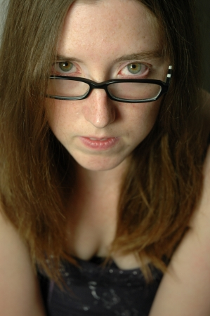eyes hazel: Beautiful young woman with black rimmed glasses Stock Photo