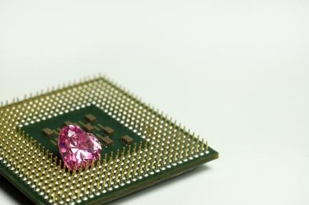 internals: Golden processor pins with pink gemstone