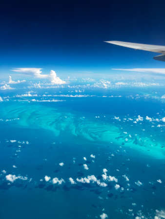 Beautiful aerial view of Bahamas sand bars and turquoise seas from a plane