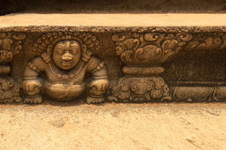 Bahirawa stone carving in intricate detail at sacred site in Anuradhapura, Sri Lanka