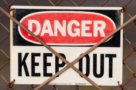 danger: Detail closeup of a sign that says danger keep out. Stock Photo