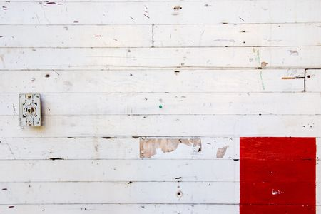 decaying: A white wall with red paint for design layouts and copy space.