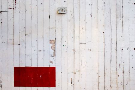 A very simple photo of a white wall with lines in the paint and a red rectangle of color. Stock Photo - 5150313