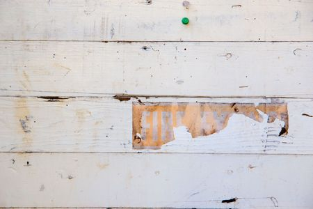 A very old white wall with a decaying sign. Stock Photo - 5150317