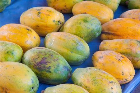 Organic papayas are sold fresh at a small farmers market along the north shore of oahu hawaii.