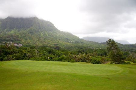 A great tropical golf course on oahu hawaii in the middle of a rainforest with magnificent greens and well manicured fairways.