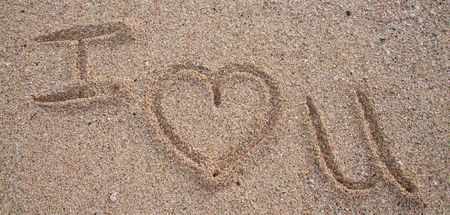 Writing in the sand spells out I Heart You in oahu hawaii. photo