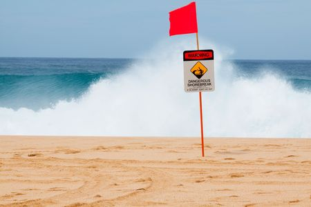 banzai pipeline: Warning signs mark where there is a very dangerous shore break and rip current along the north shore of Oahu Hawaii.