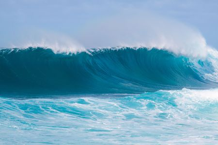 northshore: Large waves break off the north shore of oahu hawaii during a great time for surfers surfing.