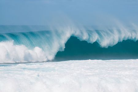 oahu: Large waves break off the north shore of oahu hawaii during a great time for surfers surfing.