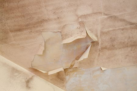 Details of a wall in very bad shape including discoloration and markings, great textured background images with copy space. Stock Photo - 6301423