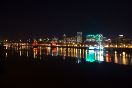 willamette: Photos of downtown portland oregon at night showing the busy urban city life of this northwest metro area. Stock Photo