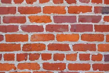 worn: Abstract image of a red brick wall with mortar. Background texture photograph.