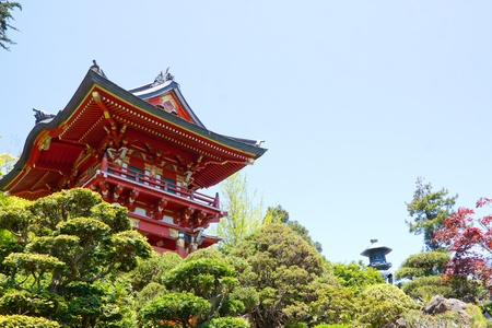 A bright red Japanese pagoda building in a tea garden sits peacefully. Stock Photo - 12903243