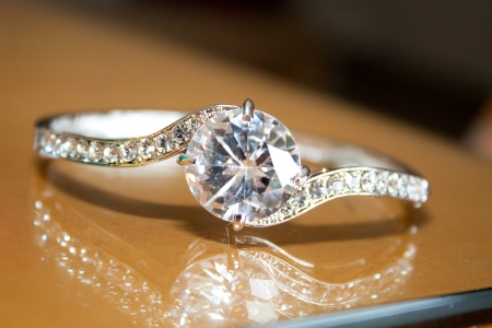A diamond wedding band (ring or jewelry) of a bride for her wedding ceremony.