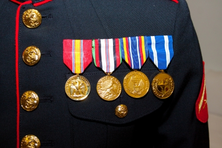 A US marine shows off his medals from active duty in the armed forces