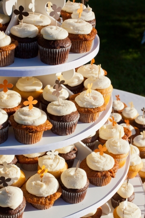 Wedding cupcakes of chocolate, vanilla, and carrotcake at a wedding reception. photo