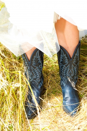western attire: A bride wearing her black and blue cowboy (or cowgirl) boots on her wedding day.