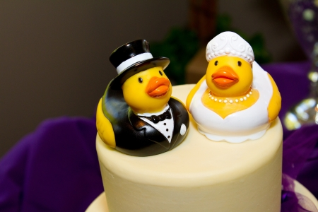 topper: Rubber ducks are the cake toppers for this wedding cake at a very non-traditional reception for the bride and groom. Stock Photo