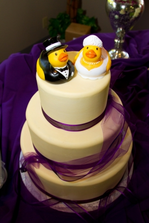 Rubber ducks are the cake toppers for this wedding cake at a very non-traditional reception for the bride and groom. Stock Photo - 16947255