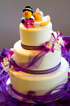 nontraditional: Rubber ducks are the cake toppers for this wedding cake at a very non-traditional reception for the bride and groom. Stock Photo