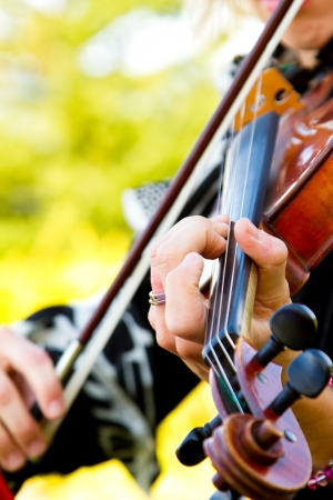 A close-up detail of a woman playing the violin at a wedding. Reklamní fotografie