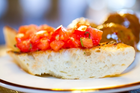 Tomato bruschetta covers this hearty bread as an appetizer at a wedding reception  photo