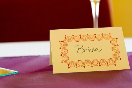 tage: This name tag says bride to reserve her spot at a wedding dinner table.