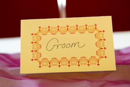 reserved seat: This name tag at a wedding says groom to reserve his spot at a table. Stock Photo