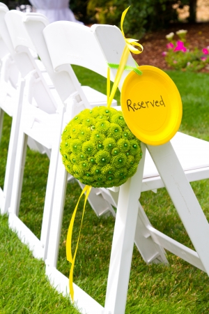 round chairs: Flowers are placed together to create these unique green floral balls for wedding decor. Stock Photo