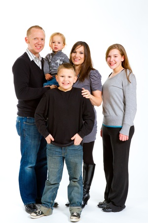 familiy: A family of five people on a white isolated background in the studio.