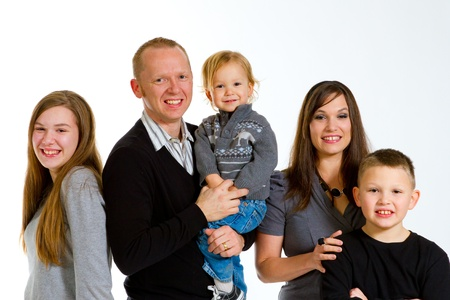 A family of five people on a white isolated background in the studio. photo