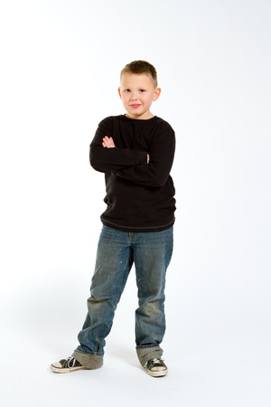 A young boy in the studio for a portrait against a white background.