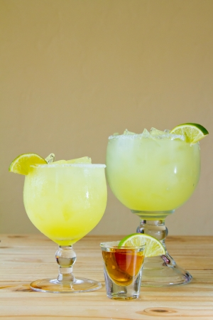 Margaritas at a Mexican restaurant with a shot of tequila and a lime. Stock Photo