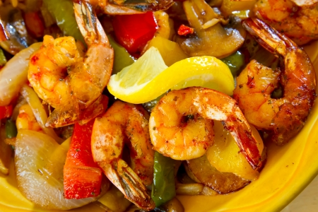 Een authentiek Mexicaans eten restaurant heeft vergulde fajita's klaar om te serveren. Stockfoto