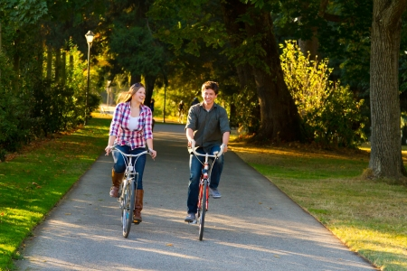 A man and a woman with their bicycles on a bike path in an outdoor park setting. Stock Photo - 17423922