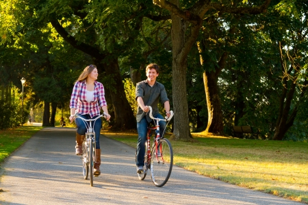 A man and a woman with their bicycles on a bike path in an outdoor park setting. Stock Photo - 17423901