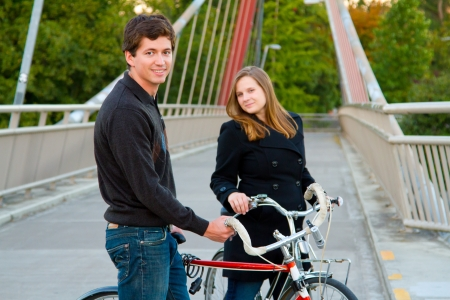 A married man and woman with their bikes on a bicycle path bridge. Stock Photo - 17423918