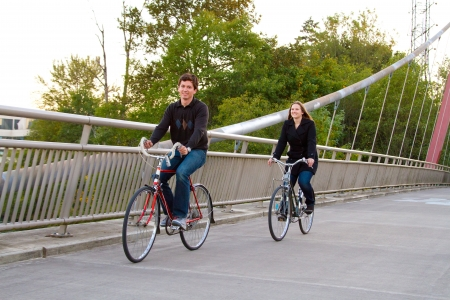 A married man and woman with their bikes on a bicycle path bridge. Stock Photo - 17423883