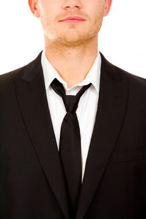 This handsome groom is isolated against a white background in the studio to create a portrait of a man that could be getting married or could be a business person. photo