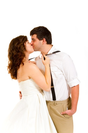 An attractive woman and her handsome husband wear their wedding attire in the studio agains an isolated white background. photo
