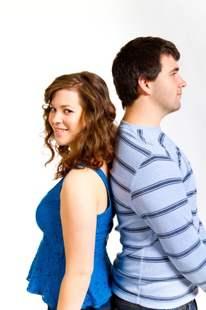 A white background studio shot of a young couple in blue fashionable stylish outfits. photo