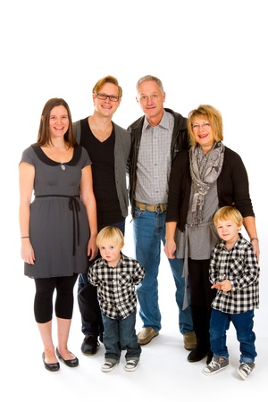 This group of six people includes three generations on an isolated white background in the studio. photo